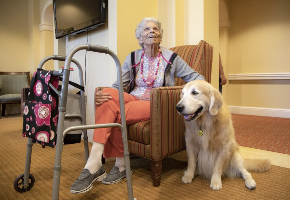 Resident with therapy dog